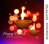 colorful diwali diya greeting... | Shutterstock .eps vector #324799763