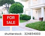 real estate sign in front of... | Shutterstock . vector #324854003