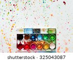 tray of paints on spotted by... | Shutterstock . vector #325043087