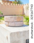 """Small photo of """"Place 20 Aout"""" in Taroudant, Morocco - vintage quern"""