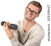 funny weak man tries to lift a... | Shutterstock . vector #325190417