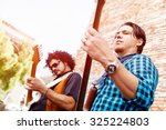 band of musicians playing in... | Shutterstock . vector #325224803