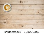 coffee cup on wood table with...   Shutterstock . vector #325230353