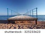 wooden pier leading to sea | Shutterstock . vector #325233623