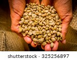 hand holding cofee beans from... | Shutterstock . vector #325256897