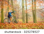 active woman riding bike... | Shutterstock . vector #325278527