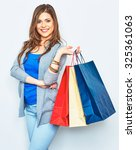 Happy Shopping Woman Holding...