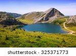view of enol lake  in summer....   Shutterstock . vector #325371773