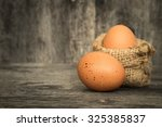 Two Fresh Eggs On Wooden...