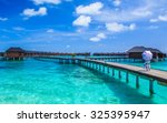 tropical beach in maldives with ... | Shutterstock . vector #325395947