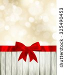 red ribbon bow with bokeh ... | Shutterstock .eps vector #325490453