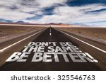 Small photo of Don't Be the Same, Be Better! written on desert road