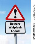 Small photo of Red and white triangular road sign with warning to Beware of Whiplash Ahead concept against a partly cloudy sky background