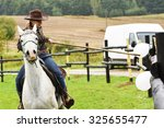 beautiful cowgirl riding a... | Shutterstock . vector #325655477