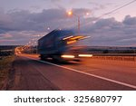 truck on a highway in the night | Shutterstock . vector #325680797