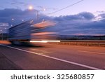 truck on a highway in the night | Shutterstock . vector #325680857