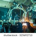 team welding robots represent... | Shutterstock . vector #325692713