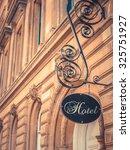 ornate sign for luxury hotel... | Shutterstock . vector #325751927