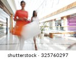 women walking fast in shopping... | Shutterstock . vector #325760297