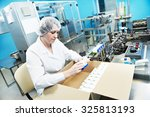 pharmaceutical factory worker... | Shutterstock . vector #325813193