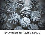 white fir cones on wooden... | Shutterstock . vector #325853477