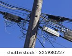 Small photo of Telephone Terminals in Disarray on Phone Pole