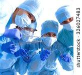 team of surgeon in uniform... | Shutterstock . vector #326027483
