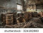 Rusty Barrels Stored In An...