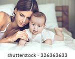 portrait of beautiful mother... | Shutterstock . vector #326363633