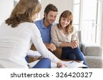 Real Estate Agent Presenting A...