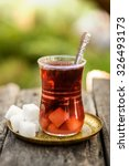 Small photo of Turkish tea with traditional crystal tea glass and cube sugar