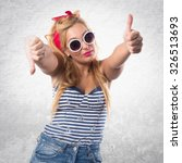 pin up girl making good bad sign | Shutterstock . vector #326513693