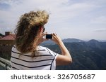 young female hiker taking photo ... | Shutterstock . vector #326705687
