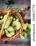 Unripe  Green Tomatoes In A...