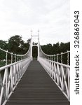 Small photo of White bridge in city park at Bung Ta Lua Water Park Nakhon Ratchasima, Thailand