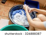 women washing clothes the... | Shutterstock . vector #326888387