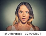 concerned scared shocked woman | Shutterstock . vector #327043877