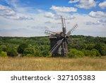 windmill in field. old wooden... | Shutterstock . vector #327105383