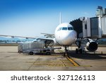 airplane near terminal. | Shutterstock . vector #327126113
