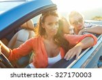 two young happy girls driving a ... | Shutterstock . vector #327170003