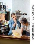 mid adult female worker looking ...   Shutterstock . vector #327358343