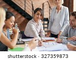 architects working on plans at... | Shutterstock . vector #327359873