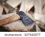 Axe Lies On A Stump On A...