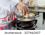 chef seasoning soy sauce and...