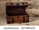 Open Vintage Chest On Wooden...