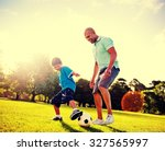 little boy playing soccer with... | Shutterstock . vector #327565997