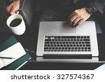 businessman using laptop... | Shutterstock . vector #327574367