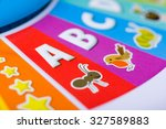 Small photo of A close up shot of a colorful kid's toy with the ABCs, animals and stars on it.