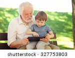 grandson and grandfather using... | Shutterstock . vector #327753803