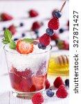 strawberries in coconut.... | Shutterstock . vector #327871427